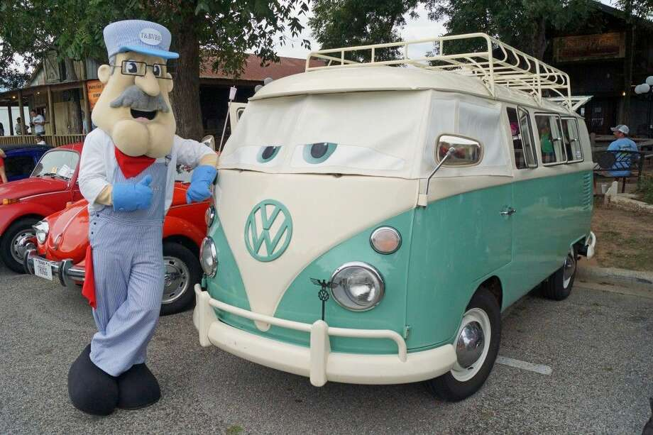 "Tomball's mascot, Rusty Rails, poses at the annual ""Bugs, Brew & Barbecue"" celebrating the classic Volkswagen ""Bug"", Texas craft beer, and local barbecue. More than 6,400 guests attended the award winning event in 2014. Photo: Submitted"