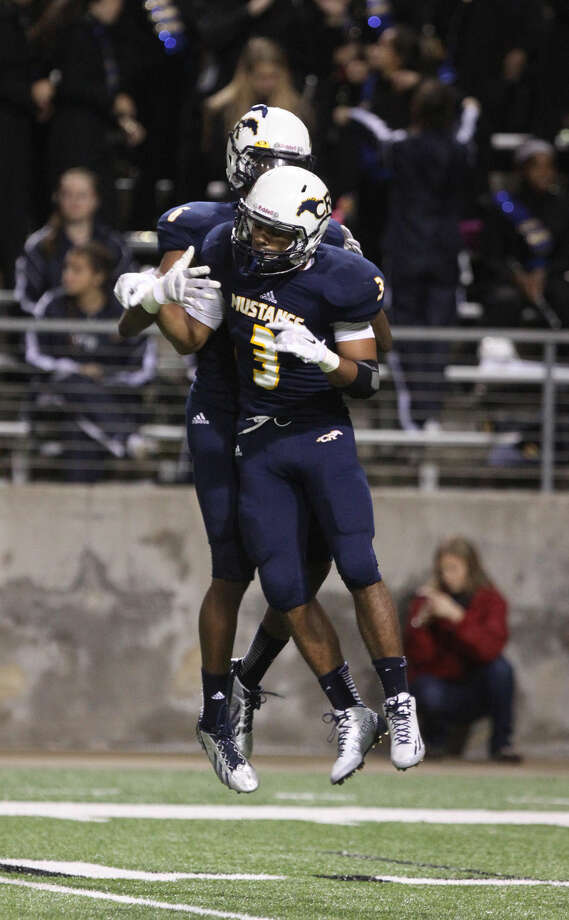 Cypress Ranch's Joseph Johnson celebrates a touchdown against Cinco Ranch during the Class 6A Division I Football Area Playoffs at Berry Center Stadium in Cypress, Texas on Friday, November 21, 2014. Photo: Staff Photo By Alan Warren