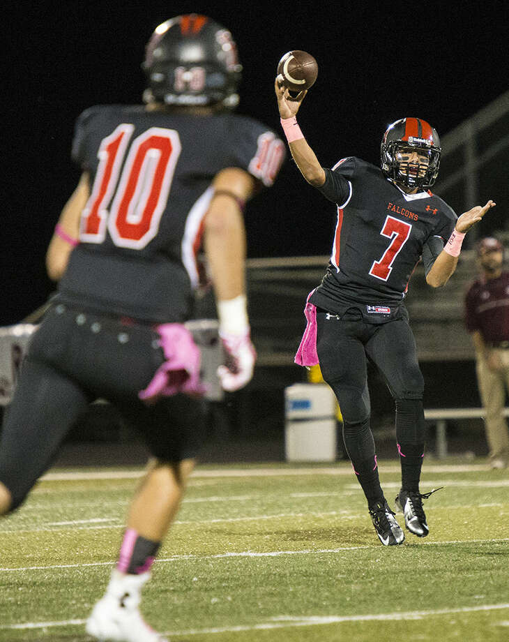 Falcons quarterback Cody Gaitan passes during Huffman's victory over Silsbee on Oct. 3, 2014, at Hargrave High School.