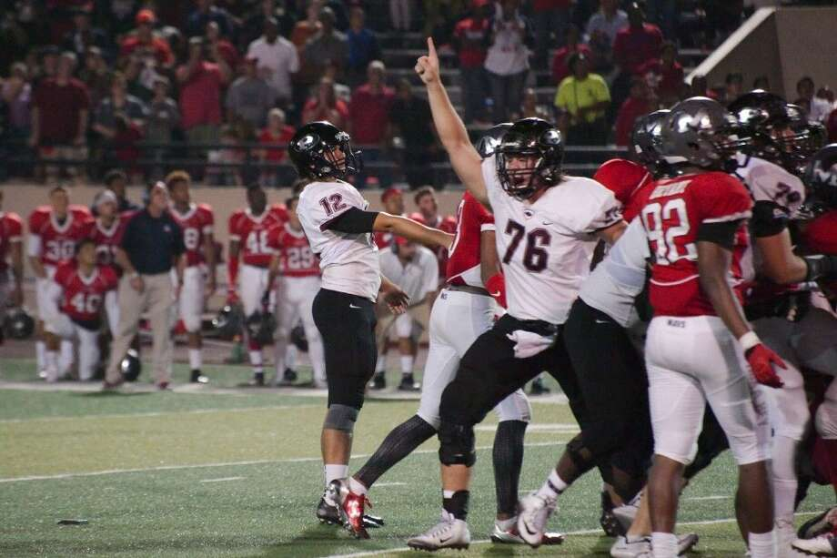 Pearland's Adam Jewell (76) confirms the game-winner as Oiler Cody Bernstien (12) watches his 37-yard field goal defeat Manvel as time expired Friday night for a 27-24 Pearland victory. Photo: KIRK SIDES