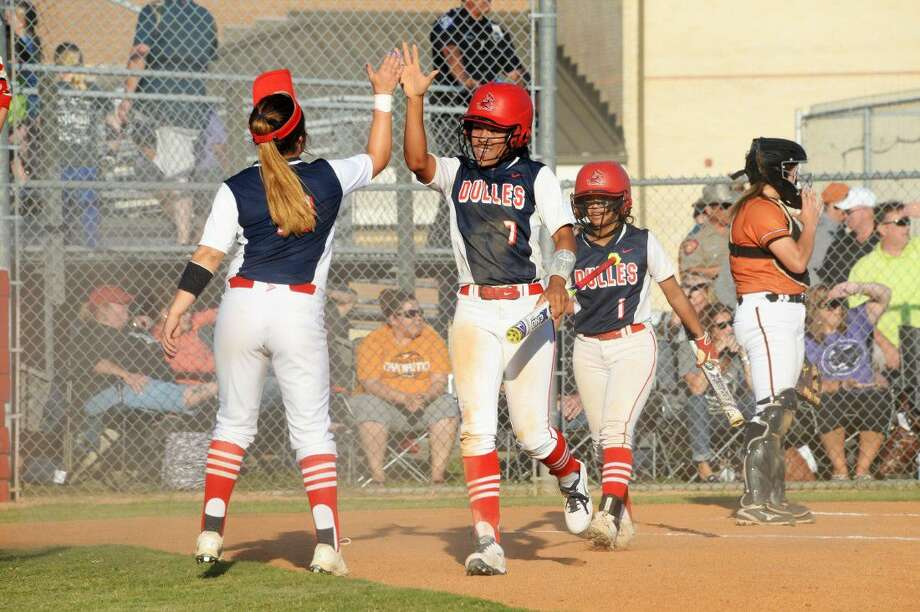 Dulles' Caela Kincade (7) celebrates after scoring against Allen during the Region III-6A area playoffs May 6 at Dulles High School. Kincade was voted District 23-6A MVP, with teammate Chessi Olivas (1) making the first team. View this and additional photos at HCNPics.com. Photo: Craig Moseley