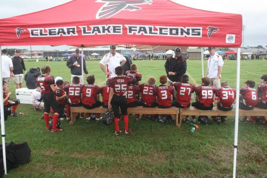 The Clear Lake Sophomore Falcon coaching staff hash over the first half with the guys during Saturday's morning's playoff game with the San Jacinto Ravens. Outside of allowing a rare touchdown, the coaches had few complaints midway through the contest and even fewer at game's end. Photo: Robert Avery