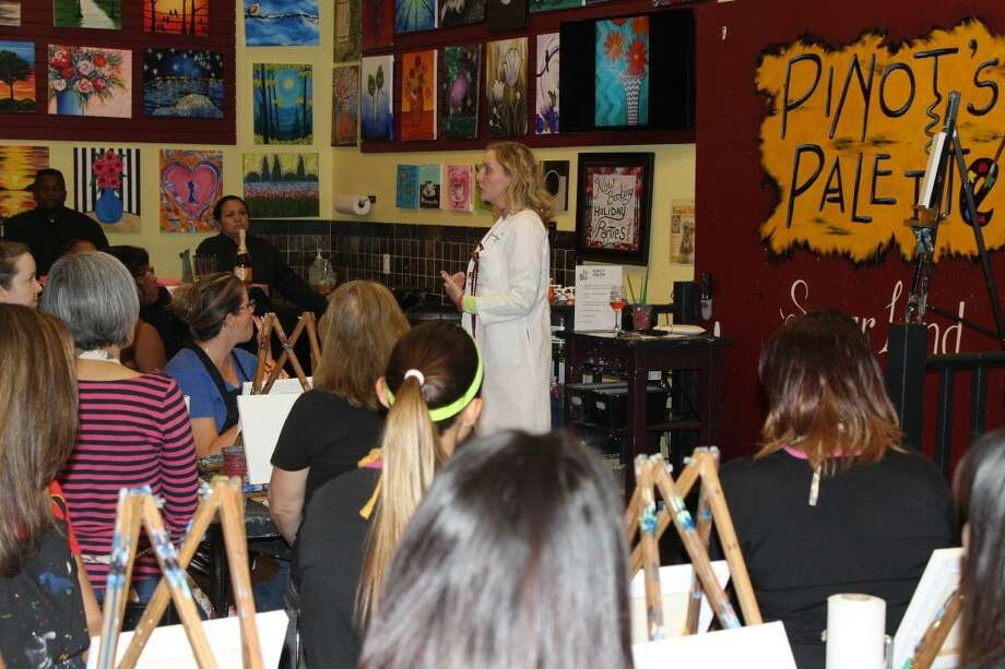 Dr. Kelly Dempsey, breast surgeon, affiliated with Memorial Hermann Sugar Land Hospital, hosts a question and answer session for a large gathering of women at The Art of Knowing event at Pinot's Palette in Sugar Land.