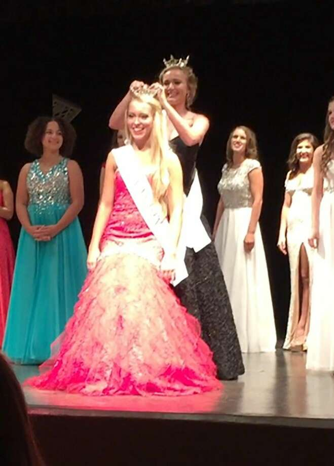Cypress Ranch sophomore Bailey Stark is crowned Miss Katy's Outstanding Teen on Oct. 26. In the competition, Stark underwent extensive interviews with a panel of judges who also graded her on talent, fitness, poise, on-stage questions and evening gown.