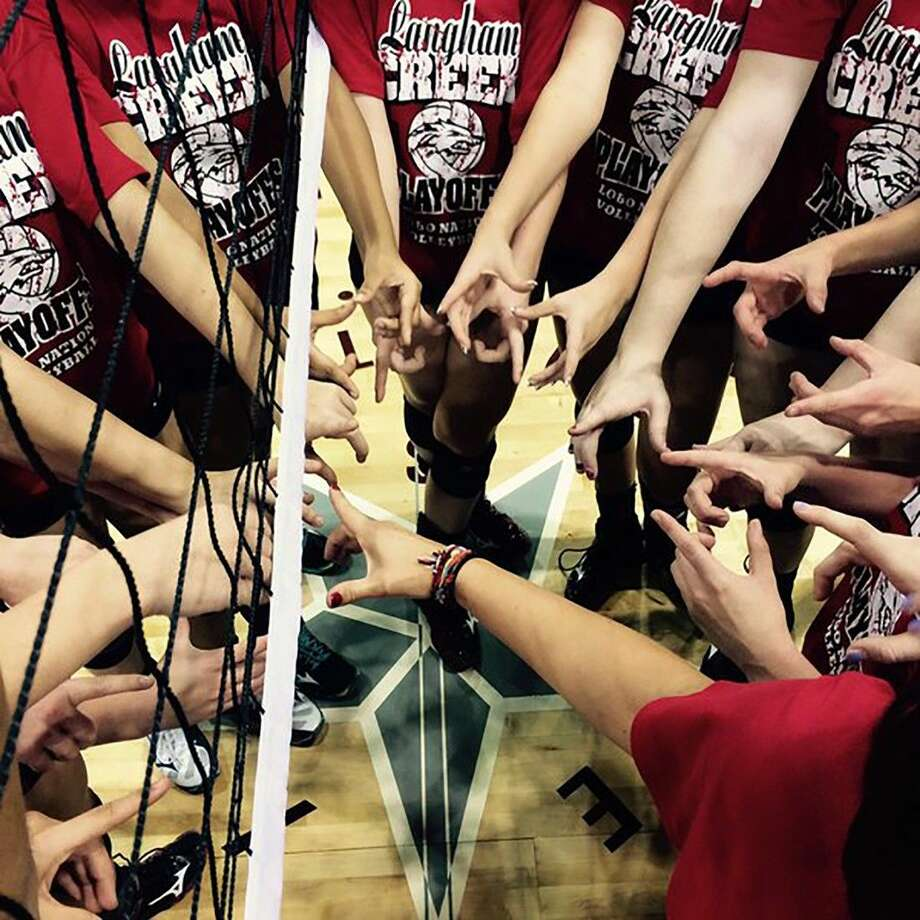 "The Langham Creek High School volleyball team displays the ""LC"" logo after defeating Aldine Davis on Nov. 3 to advance to the area playoffs, where the Lobos will meet Bellaire on Nov. 6 at Coleman Coliseum."