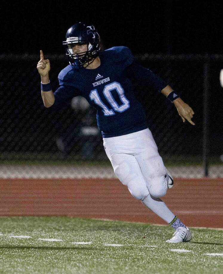 Kingwood quarterback Dawson Trudell celebrates after scoring a two-point conversion in the fourth quarter of a District 16-6A football game November 5, 2015, in Humble. To view or purchase this photo and others like it, visit HCNpics.com. Photo: Jason Fochtman