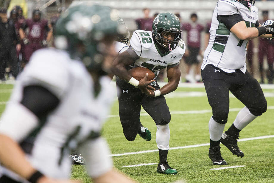 Panthers running back Robert Washington (22) breaks up the field during Kingwood Park's 35-14 area playoff loss to George Ranch on Nov. 22, 2014, at Berry Center in Cypress. Photo: ANDREW BUCKLEY