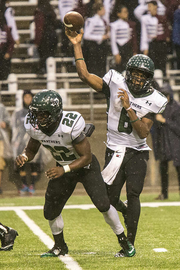 Panthers quarterback Jaylon Henderson (6) passes as the rain pours down during Kingwood Park's 35-14 area playoff loss to George Ranch on Nov. 22, 2014, at Berry Center in Cypress. Photo: ANDREW BUCKLEY