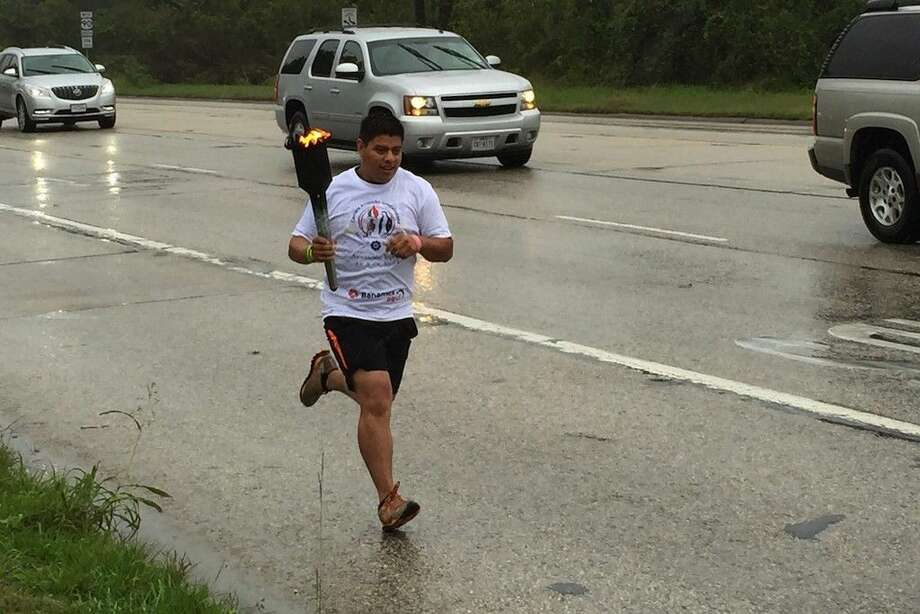 Torch bearers with Carrera Antorcha Gaudalupana made their way through Dayton and Liberty, Texas on Saturday, Nov. 7, as part of a relay that has carried a torch from Mexico City and will carry it on to New York City by Dec. 12. Photo: Casey Stinnett