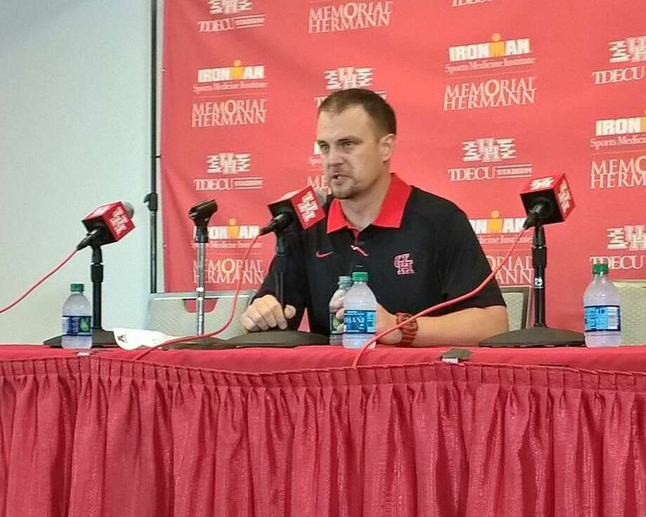 Houston Cougars coach Tom Herman answers questions after his team's 33-30 win to Cincinnati on Saturday.