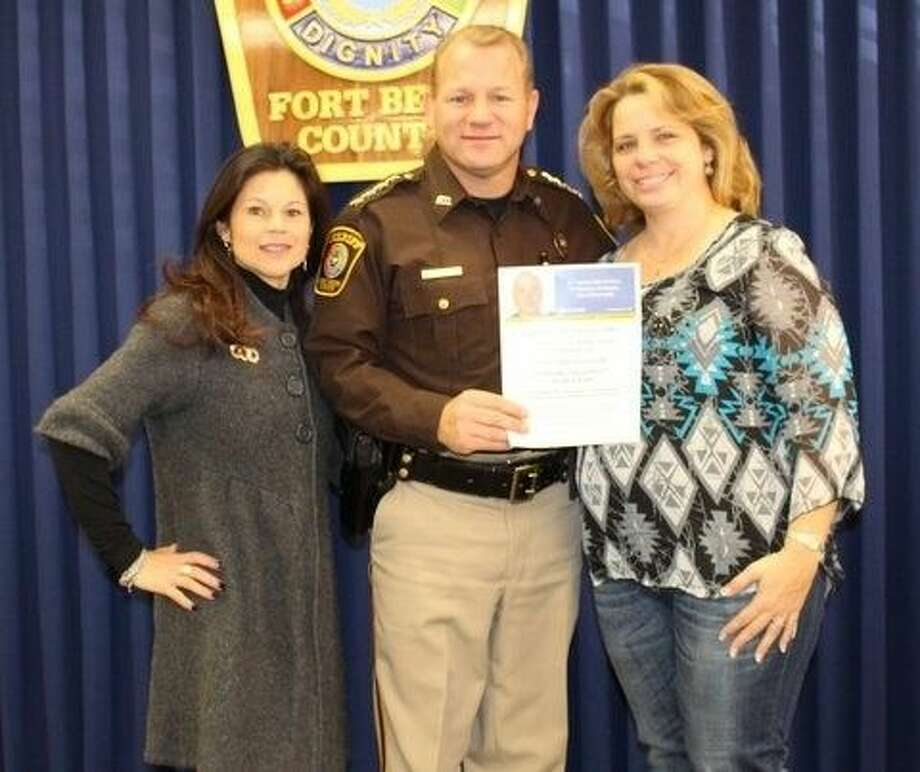 The Fourth Annual Deputy John Norsworthy Blood Drive is set for Wednesday, Dec. 3 at the Fort Bend County Sheriff's Office, 1410 Williams Way Blvd. in Richmond. Preparing for the event are, from left, Brenda DeFrayne, Gulf Coast Regional Blood Center; Sheriff Troy E. Nehls; and Melissa Norsworthy. Photo: Picasa