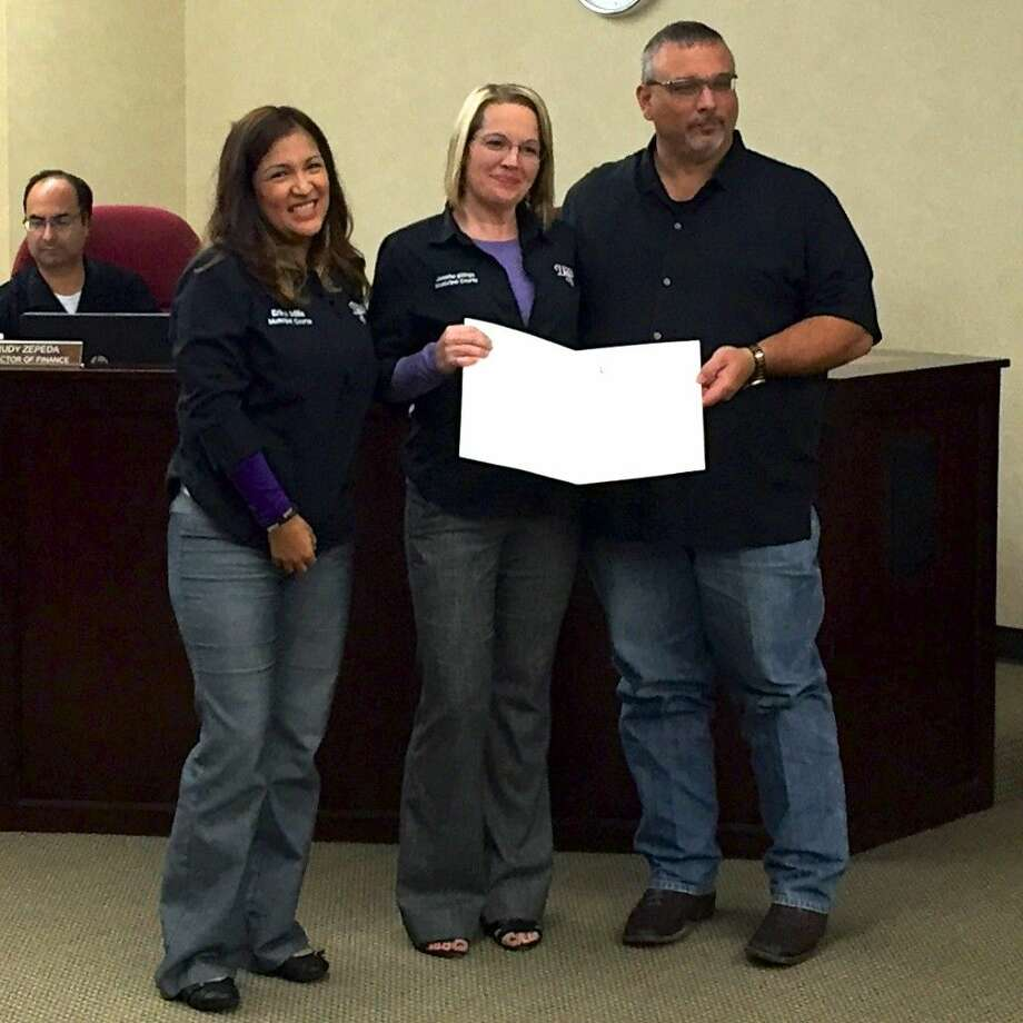 Dayton Mayor Jeff Lambright presents a proclamation to Dayton Municipal Court administrators Erika Mills and Jennifer Billings thanking them for the services provided by the municipal court. Photo: Casey Stinnett