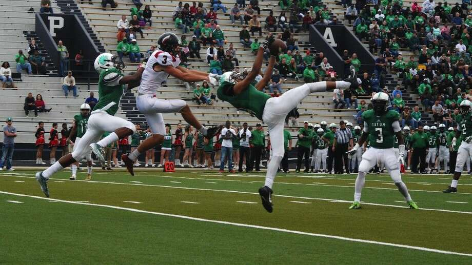 This was very nearly, but not quite, an interception for Tatum by Jordon Nelson during the Eagles' 35-12 win over the Coldspring Trojans for the Area title, Nov. 22, 2014. Photo: Casey Stinnett