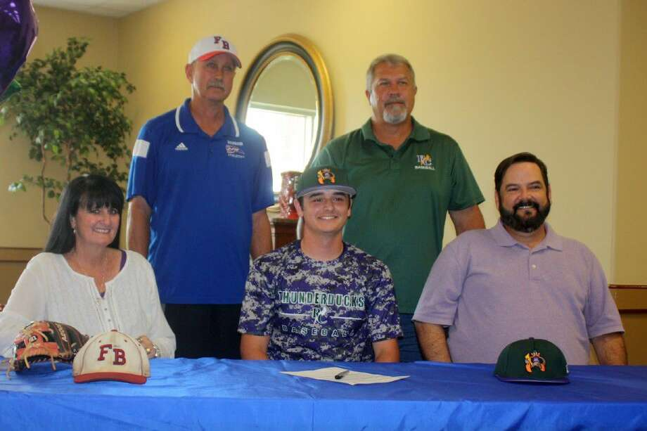 Pasadena-First Baptist Christian Academy's Nace Sweeney officially extended his baseball career to the collegiate level when he signed with Richland College in Dallas. In addition to his parents present for the big moment, Warriors head coach David Turner (left) and Richland coach Guy Simmons were also on hand. Photo: Robert Avery