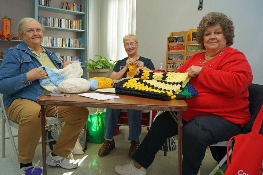 "Marie Dussling, at right, and other members of ""Happy Hands"" at the Tomball Community Center knit items for local Veterans and their children throughout the year. Photo: Submitted"