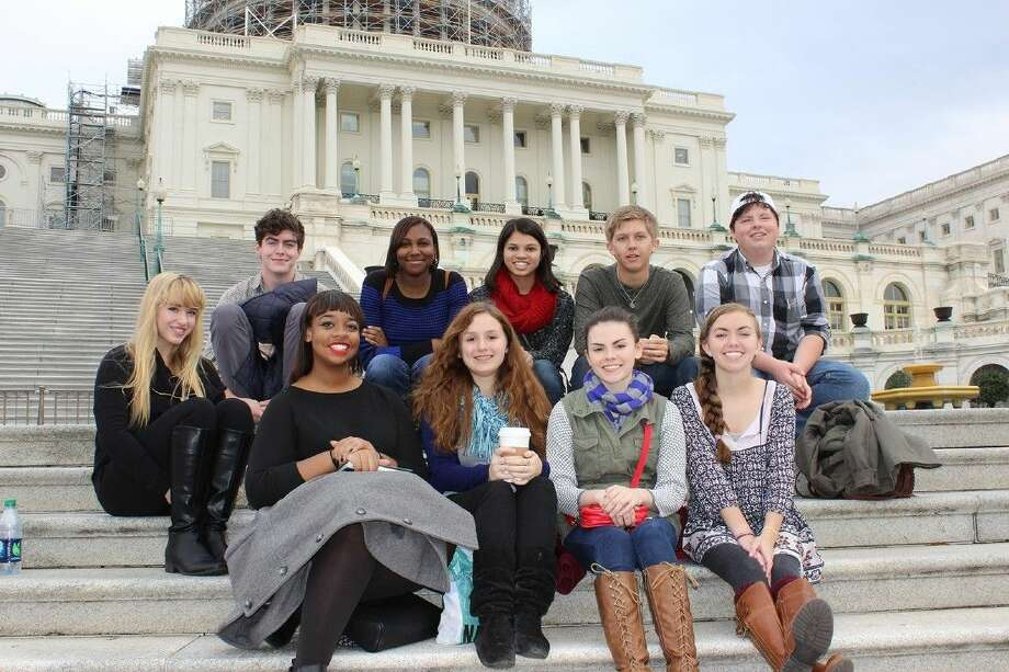 Cy-Fair High School students stand in front of the United States Capitol during their visit to Washington, D.C., for the National High School Journalism Convention, which resulted in five awards. Pictured (back row, from left) are Julia Ryza, Jared Huffstetler, Skylar Taylor, Emme Enojado, Will Davis and John Sanchez; and (front row) Kaylin Jones, Madeleine Pierce, Natalie Berry and Harper Neitzey. Photo: Submitted Photo