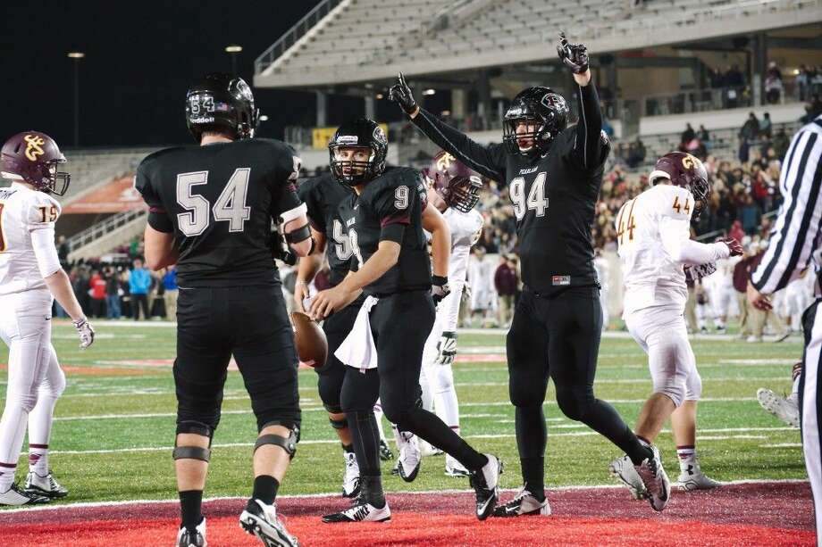 Pearland quarterback Jacob Whitehead (9) is congratulated by tight end Ryan Deshotel (94) and Justin Lilley (54) after scoring a first-half touchdown Friday night against Deer Park.