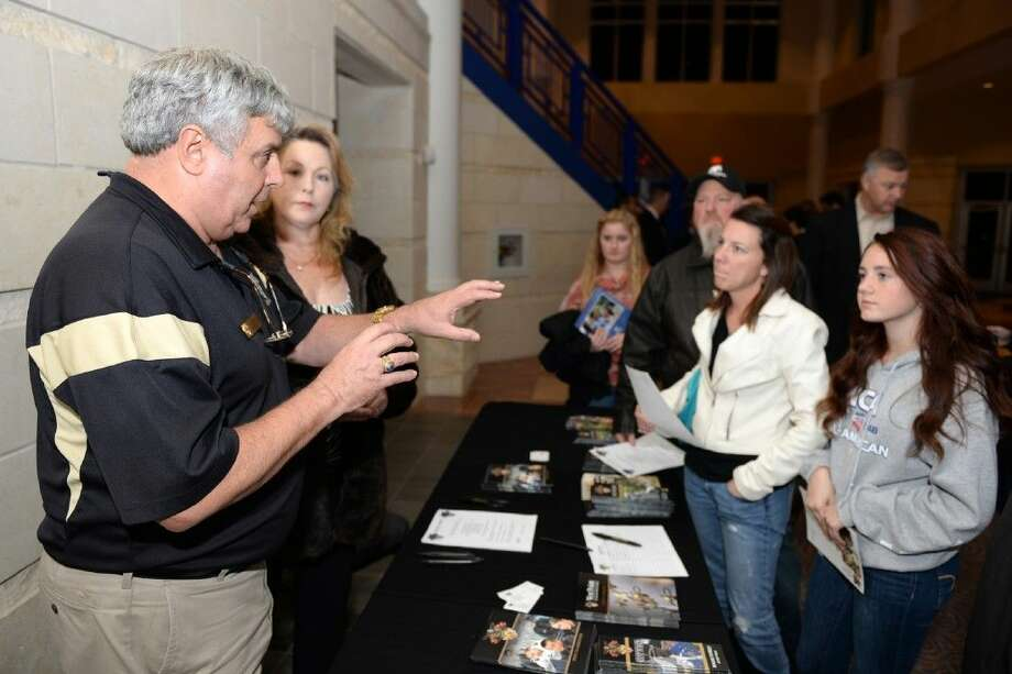 U.S. Military Academy admissions representative David Yatto speaks with a family at Military Academy Night at the Berry Center.