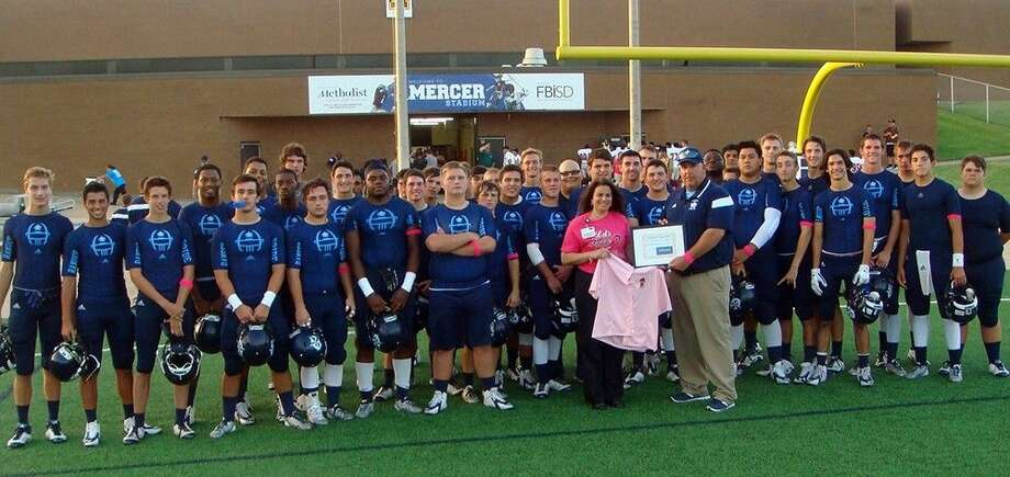 The Clements High School Varsity Football Team, Breast Care Navigator Maria Socci and Coach Keith Knowles. Photo: Submitted
