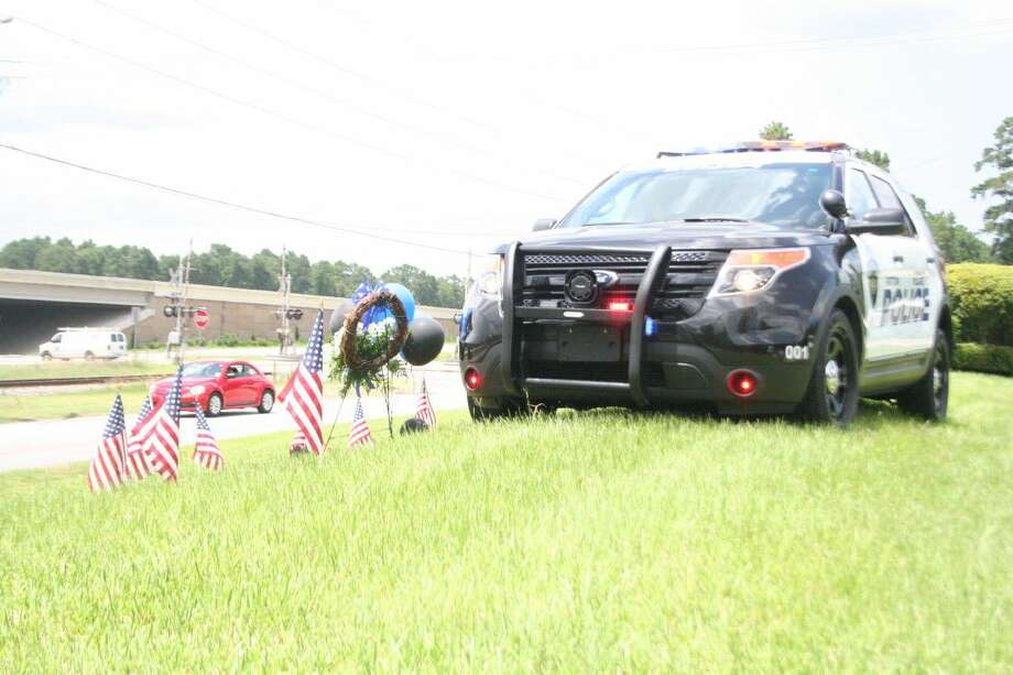 On Monday, a car was placed outside of the community center where many residents have placed flowers, wreaths and other memorabilia in honor of Sgt. Stacey Baumgartner and Adan Hilario, Jr.