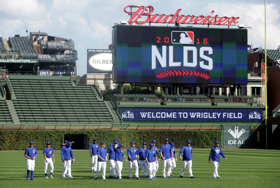 Chicago Cubs players warm up during baseball practice at Wrigley Field, Wednesday, Oct. 5, 2016, in Chicago. The Cubs host the winner of Wednesday's National League wild-card game between the New York Mets and San Francisco Giants on Friday, in Game 1 of the National League Division Series . Photo: Kiichiro Sato, AP / Copyright 2016 The Associated Press. All rights reserved.