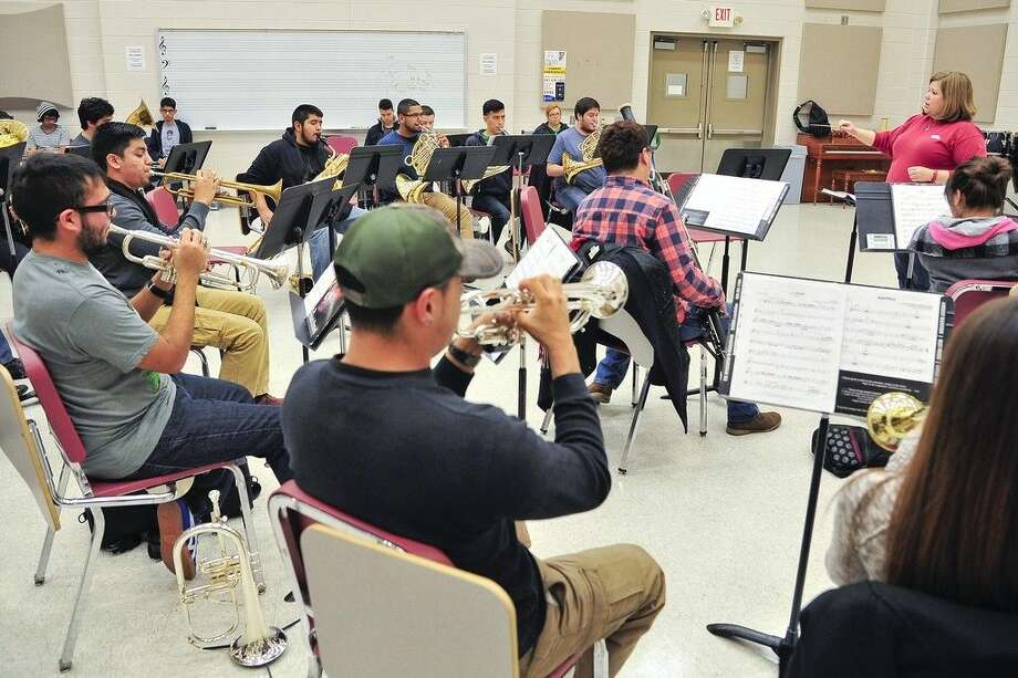 San Jacinto College music professor Amanda Dickson, right, directs student musicians practicing for the wind ensemble concert set for Dec. 2 at the North Campus. Photo credit: Rob Vanya, San Jacinto College marketing, public relations, and government affairs department.
