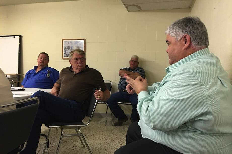 Allen Sims, vice president at LJA Engineering, Inc., at right, describes for Liberty County commissioners some of the services his company can provide to help revise the subdivision development rules. Photo: Casey Stinnett