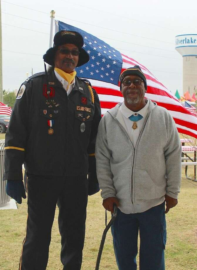 Company Man and Brazoria County Combined Honor Guard representative Harry Gaul with Clarence Sasser.