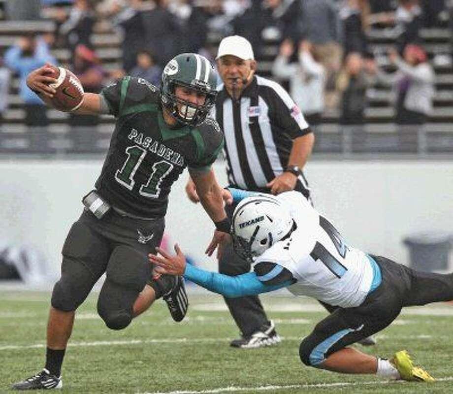 Pasadena running back Marwin Pereira (11) pushes off of a Sam Rayburn player Saturday. Photo: Kar B Hlava