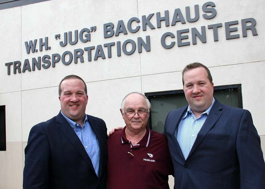 "Along with longtime Pearland ISD administrator Bob Richter (middle), Darren (left) and Kurt Backhaus remember their father's legacy at the dedication of the W.H. ""Jug"" Backhaus Transportation Center June 6."