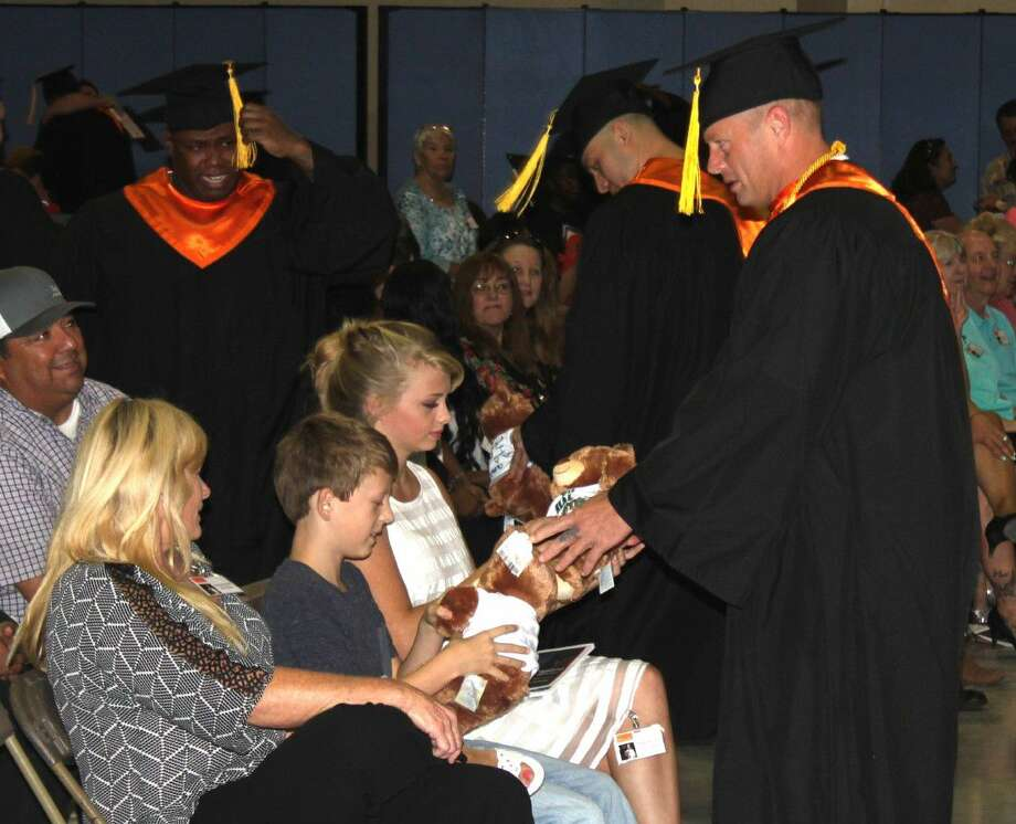 Adrian Sangster (right) delivers two special bears to his children, daughter Paiton Sangster and son Drake Sangster. Photo: Jacob McAdams