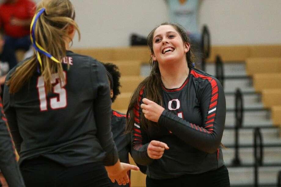 Oak Ridge's Carly Graham (11) celebrates with teammates against Klein on Tuesday at Oak Ridge High School.