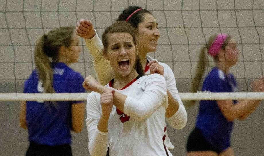 Tomball's Gabrielle Guy celebrates a point during a area playoff volleyball game Friday, Nov. 6, 2015. Photo: Jason Fochtman