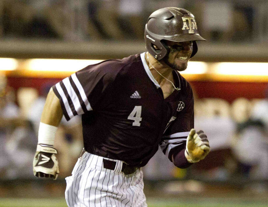 Nick Banks, of Texas A&M and former Tomball player, hits a ground ball during the seventh inning of a NCAA college baseball super regional tournament game Saturday, June 11, 2016, in College Station, Texas. Photo: Jason Fochtman
