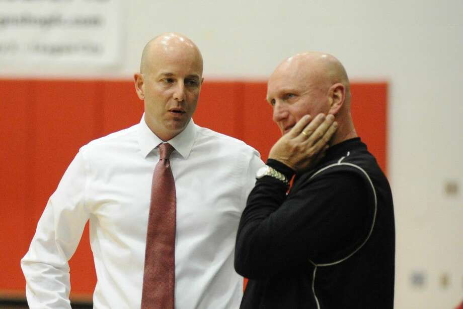 Clear Lake head basketball coach Tommy Penders (left) and Pearland head basketball coach Steve Buckelew would welcome a shot clock in high school basketball. Photo: Kirk Sides