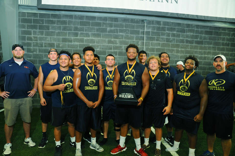 The Klein Collins linemen celebrate their victory at the 2016 Big Man's Brawl at Athlete Training + Health Saturday, June 18, 2016. Offensive guard Dante Bivens, a Tulsa commit, center, holding the trophy, said the competition was a welcome activity for the big men, who lack the 7-on-7 opportunities the skill players enjoy. Photo: Tony Gaines