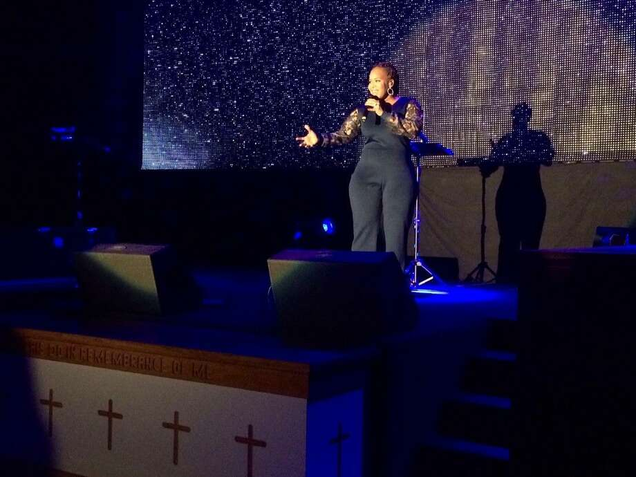 "Multi-Grammy award winning artist and WE TV star Tina Campbell sings an uplifting ballad during ""An Evening with Tina Campbell"" on Friday, Nov. 6, at The Community of Faith Church. Photo: Vagney Bradley"