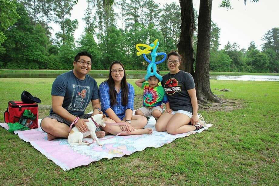 A family enjoys a picnic at Burroughs Park.