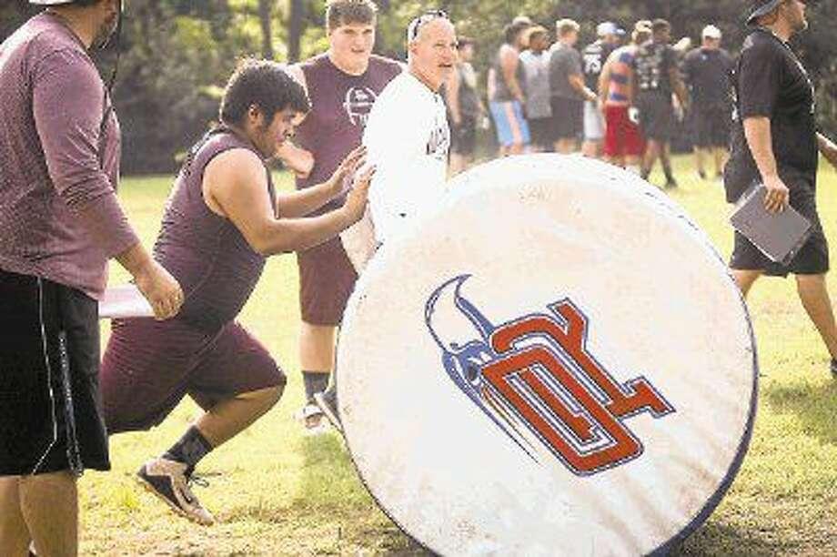 Magnolia linemen participate in the PowerDrive Push event during the Oak Ridge War Zone Lineman Challenge on Saturday at Oak Ridge High School. Photo: Michael Minasi