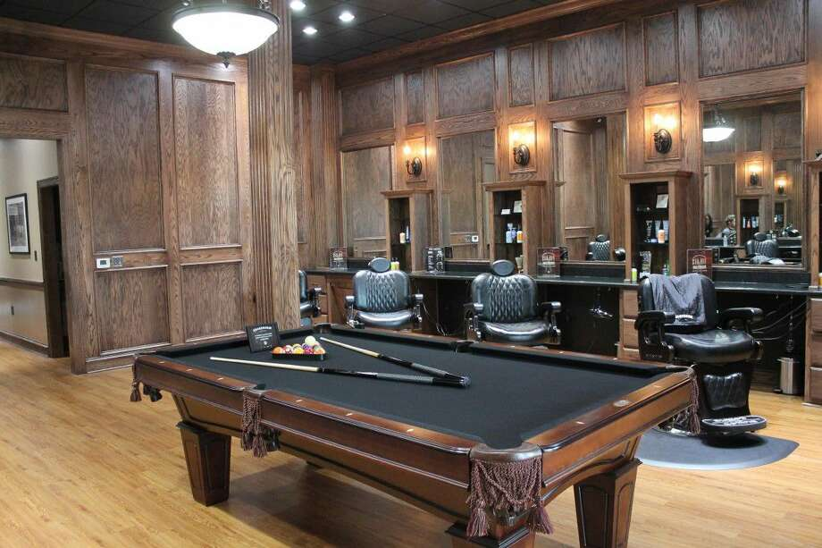 Boardroom Salon features eight barbers chairs with a pool table so clients are able to relax and have fun while being serviced. Photo: Taelor Smith