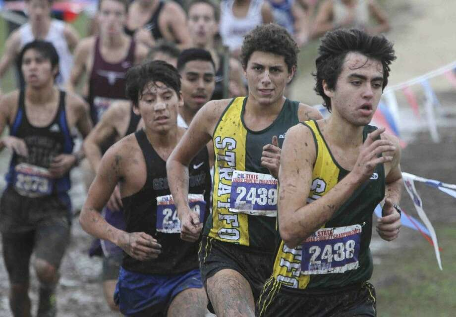 Stratford runners Sebastion Saenz-Campollo and Nick Terrazas lead a pack of mud-covered harriers Saturday morning at the UIL 5A State Cross Country Championships Saturday, Nov. 7, 2015, in Round Rock. To view more photos from the state meet, visit HCNpics.com. Photo: Jason Fochtman