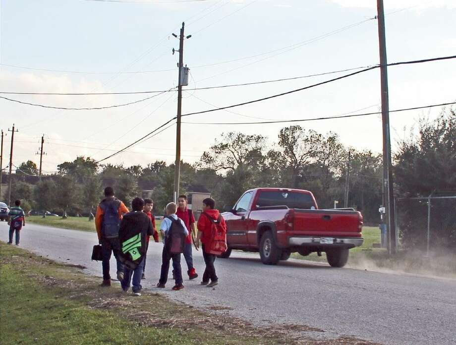 A group of fifth and sixth-graders from Keller Middle School say it's not safe for students to walk in the road and have lobbied the Pasadena City Council to install a sidewalk for months. Photo: Kristi Nix
