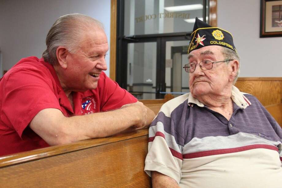 San Jacinto County Veterans Services Officer Dale Everitt visits with Billy Joe Warren inside the 411th District Courtroom at the San Jacinto County Courthouse. Everitt helped arrange the interviews included in the Cleveland Advocate/Eastex Advocate's Veterans Day 2015 edition. Both Everitt and Warren are past commanders for American Legion Post 629 in Camilla, Texas. Photo: Vanesa Brashier