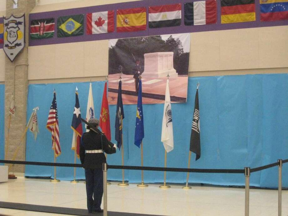 A JROTC senior cadet watches over the replica of the Tomb of Unknown Soldier during Humble High School's Wildcat Salute to Veterans Tuesday, Nov. 10, 2015.
