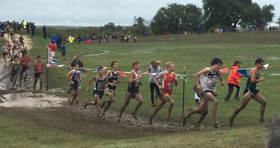 Cypress Woods High School senior Kyle Meche joins a pack of runners in muddy conditions at the UIL Cross Country State Championships at Old Settlers Park in Round Rock on Nov. 7. Meche placed 57th in the race with a time of 17:29.92.