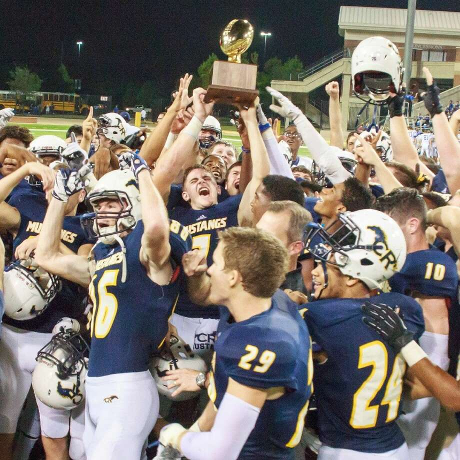 The Cypress Ranch High School Mustangs hoist the District 17-6A championship trophy after finishing with an undefeated 9-0 district record on Nov. 6 at the Berry Center. (Photo courtesy Greg Andrews) Photo: Greg Andrews
