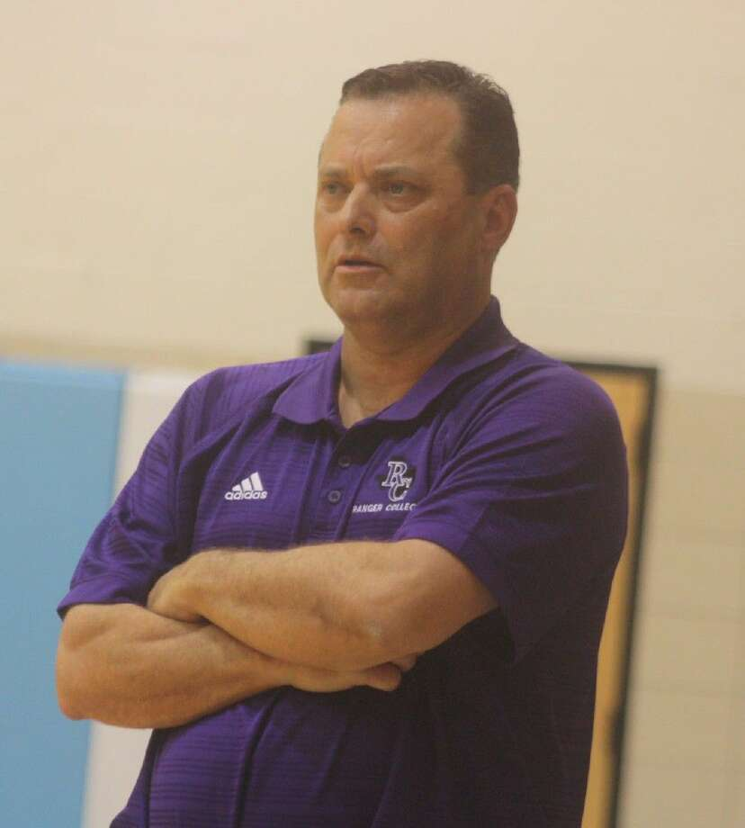 Former Texas A&M, Kentucky and Texas Tech head coach Billy Gillispie watches Ranger Junior College play defense against San Jac at Anders Gym Monday night.