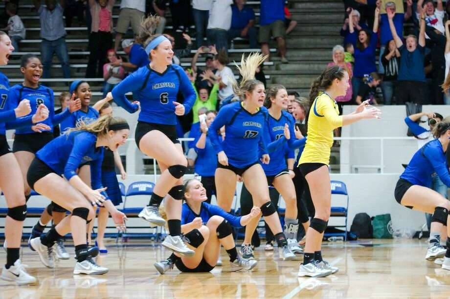 Clear Springs players rush the floor after the final point which gave the Lady Chargers a five-set victory over Pearland Tuesday night. Photo: KIRK SIDES
