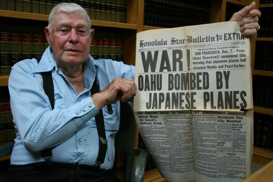 Thomas Warren Barnes displays a newspaper he has held onto for nearly 74 years, which announced the Japanese attack on Pearl Harbor on Dec. 7, 1941. Barnes is a World War II veteran from Coldspring. Photo: Vanesa Brashier