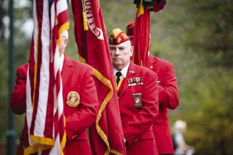 Members of the Eastex Detachment 779 Marine Corps League present the colors during the 240th birthday celebration for the United States Marine Corps on Tuesday at Town Green Park. Photo: Michael Minasi